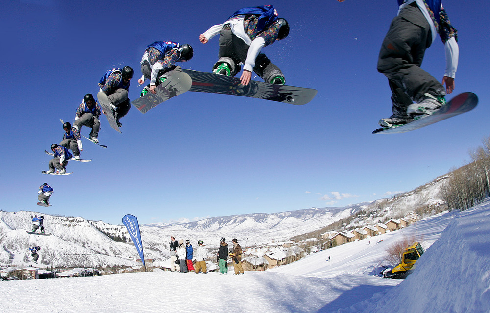 A sequence of a snowboarder performing a trick in the terrain park in Snowmass, Colorado