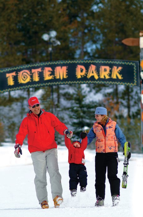 A family enjoys the snow at Crystal Mountain, Michigan