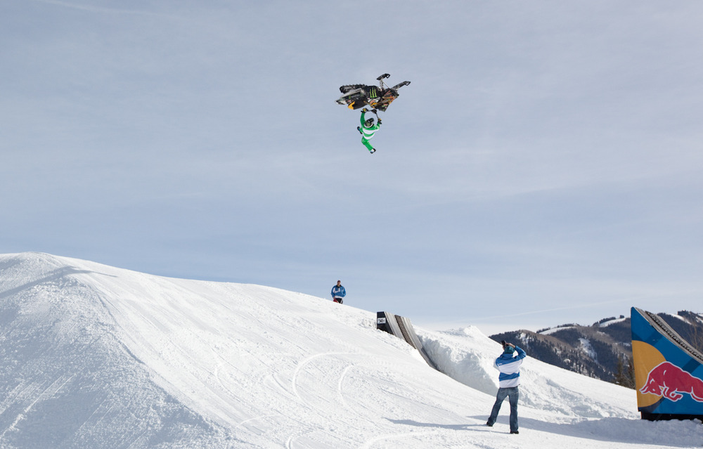Snowmobile riders practice on Sunday for best trick. Photo by Sasha Coben