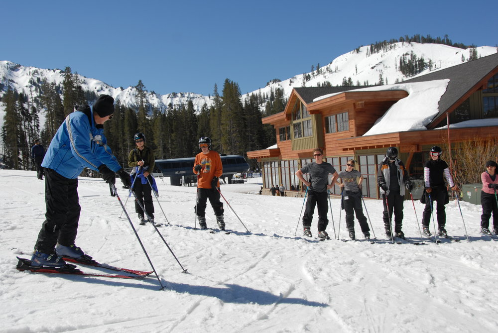 A group of skiers get lessons from an instuctor at Sugar Bowl Ski Resort, California