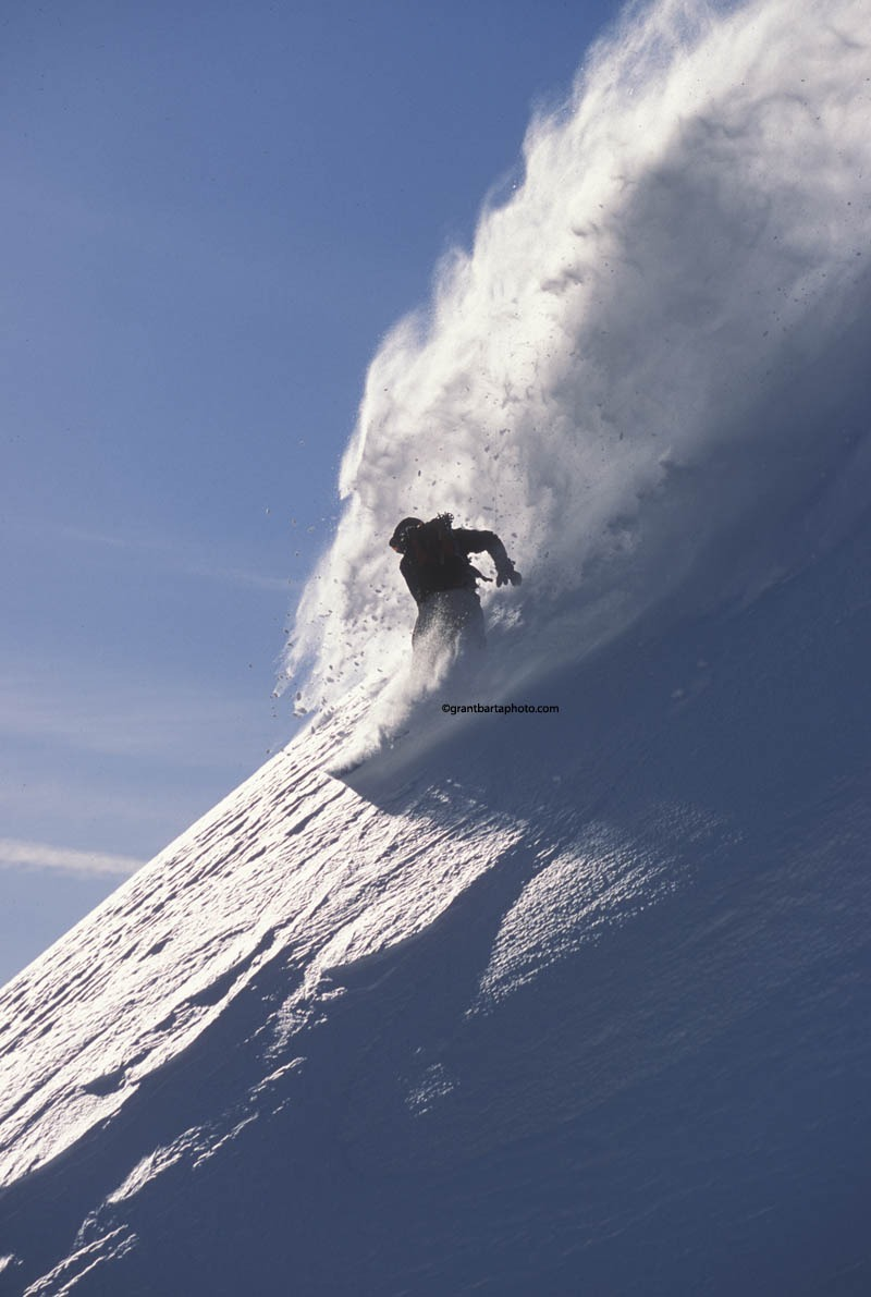 A skier enjoys new powder at Sugar Bowl Ski Resort, California
