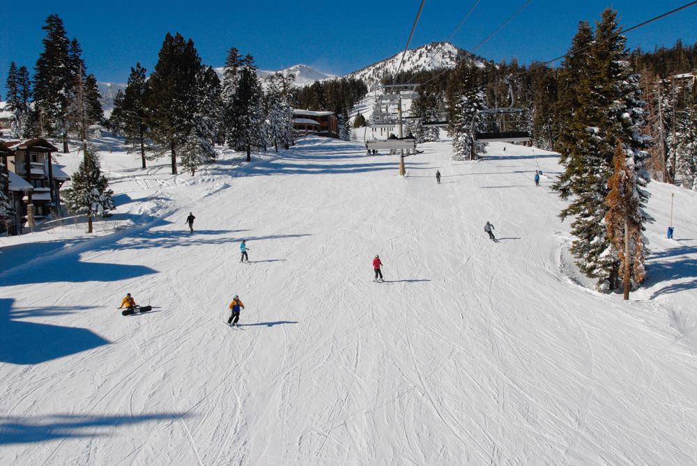 Skiers come down Mammoth Mountain, California