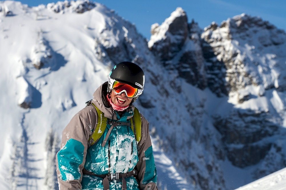 Happy skier Dex Mills is glad he didn't sleep in. Photo by Liam Doran