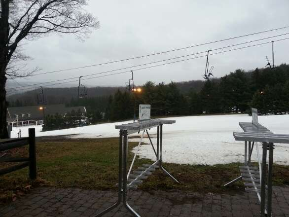 There's snow on the slopes, but... it's melting and raining here. Nonetheless, the mountain is open.