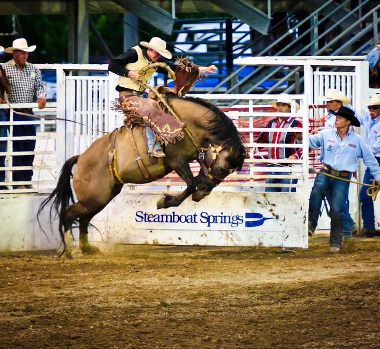 A cowboy competes in the Pro Rodeo at Steamboat Springs. Photo by Zan Blundell