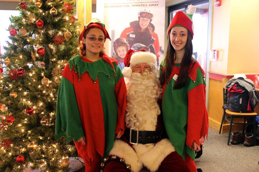 Santa poses with his elves! - © Andrew Santoro