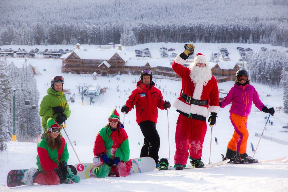 Santa shredding on his board at Lake Louise in Alberta, Canada - ©Lake Louise Resort