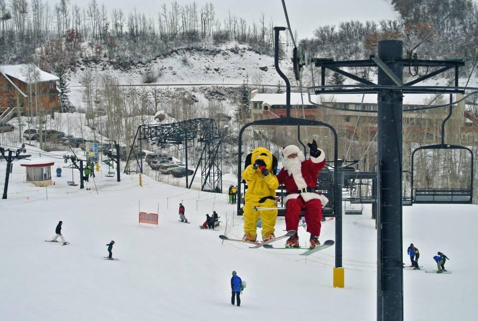 Sunny and Santa striking poses on the lift at Sunlight Mountain Resort! - ©Sunlight Mountain Resort