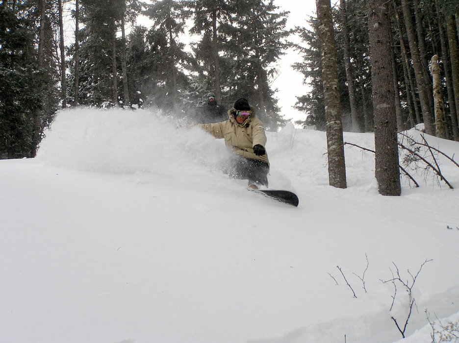 A snowboarder in the backcountry in Bretton Woods, New Hampshire