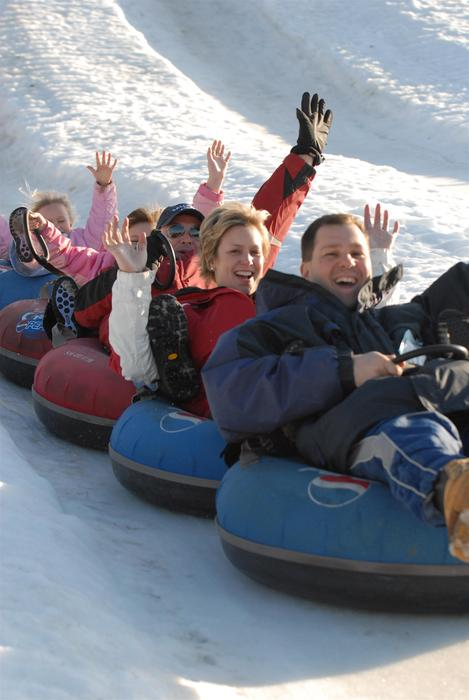 A family enjoys tubing at Bryce Resort, Virginia