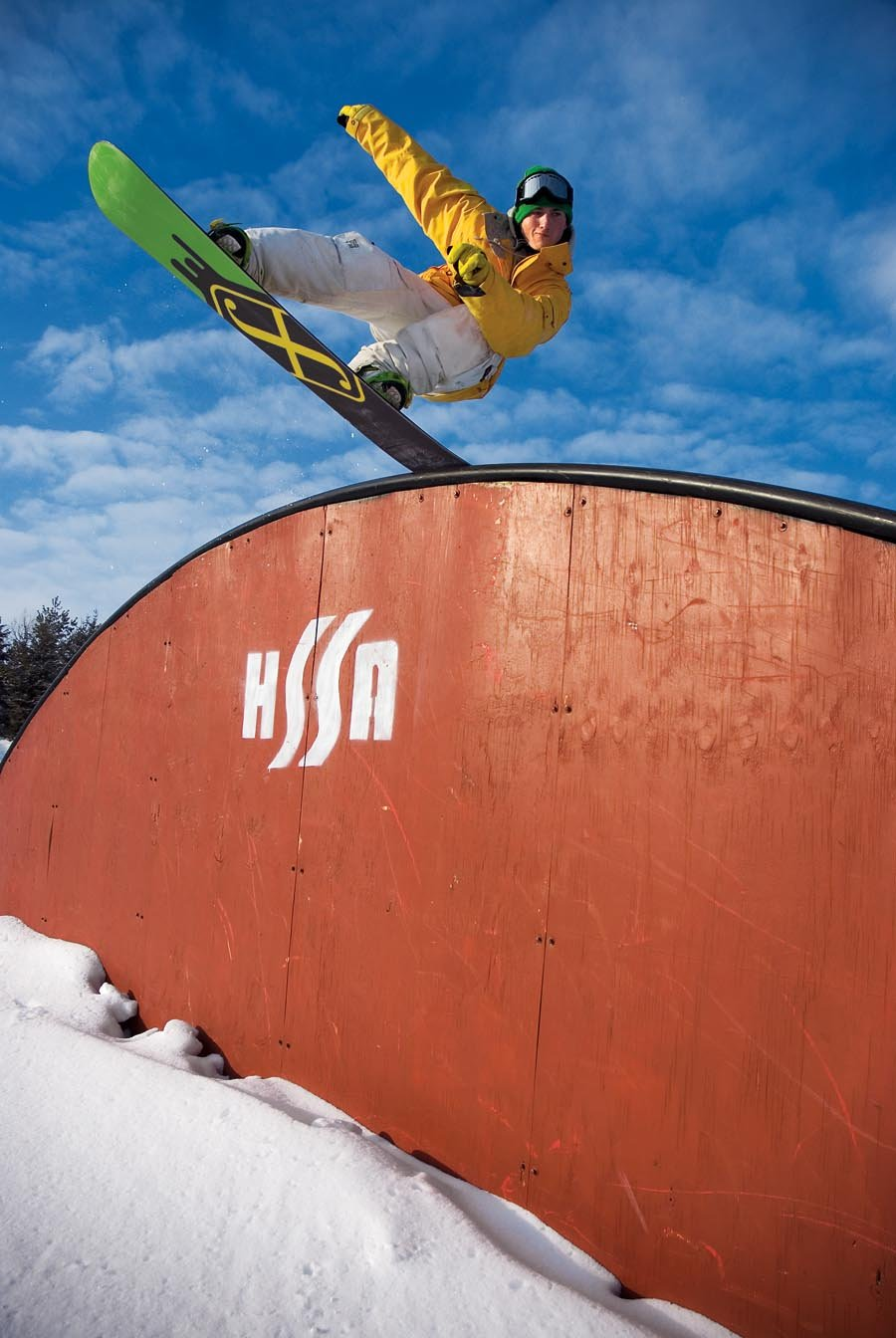 A snowboarder does a trick in the terrain park at Hyland Ski & Snowboard Area, Minnesota