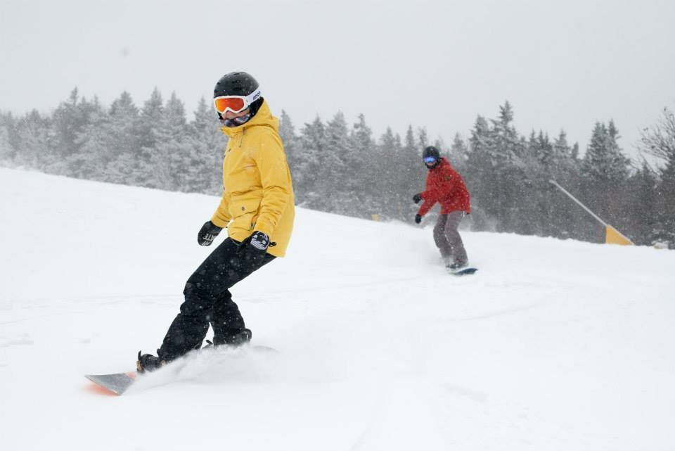 Snowboarders enjoy fresh powder at Stratton.
