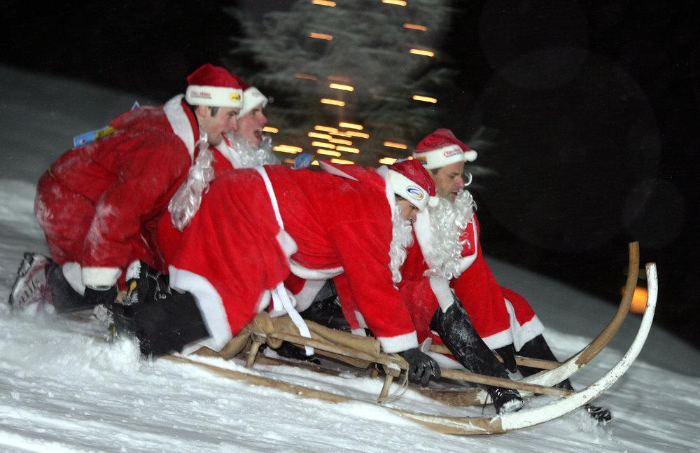 SAMNAUN - Sledge run during the winter season opening event 'Clau Wau'.  Copyright by Samnaun Tourismus      Byline: swiss-image.ch