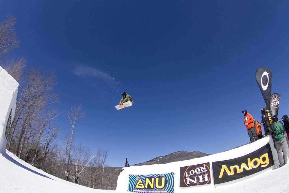 Rider, Travis Neuenhaus hits a massive gap jump in Loon Mountain Park, the biggest of Loon's six terrain parks.