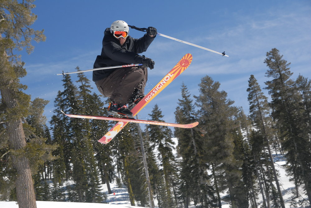 Freeskier making jump at a terrain park
