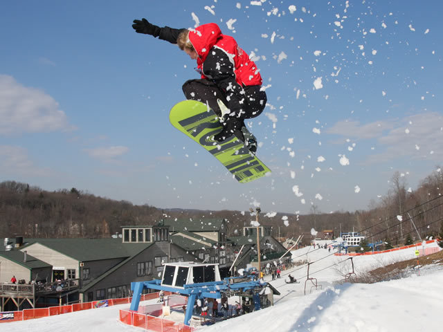 A boarder catching air at Shawnee Mtn, PA.