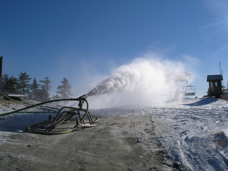 A snowgun shoots snow out onto runs at Okemo Mountain Resort, Vermont