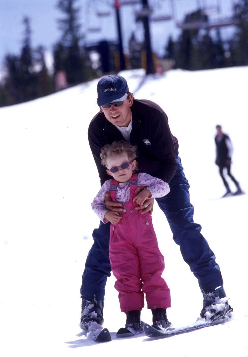 Little girl getting skiing lesson at Eldora, CO.
