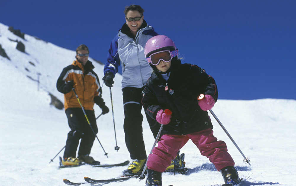 A child getting ski lessons at Mammoth Mountain, CA. Image courtesy of MMSA/Peatross