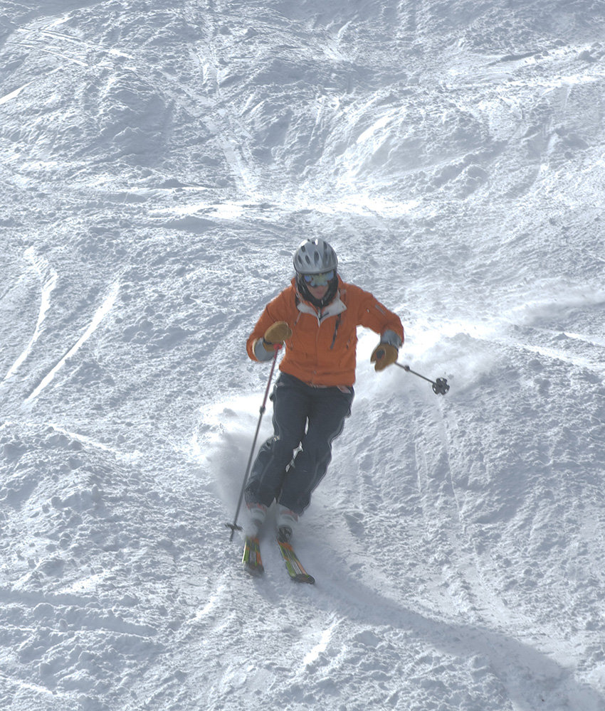 Canadian Olympic gold medalist Jean-Luc Brassard dances through moguls at Le Massif.