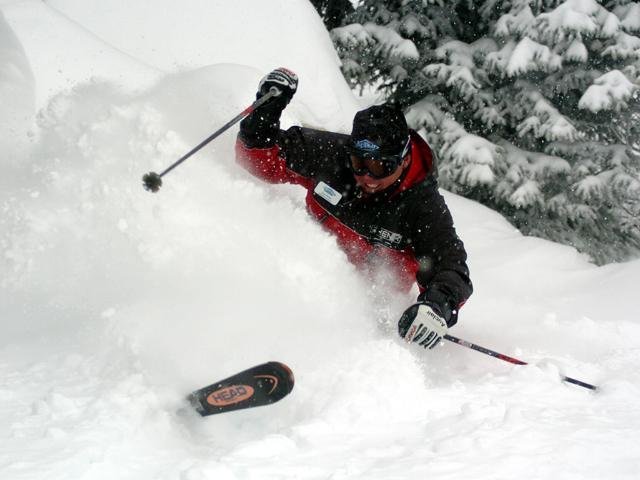 A skier engulfs himself in powder at Big White Ski Resort, B.C.