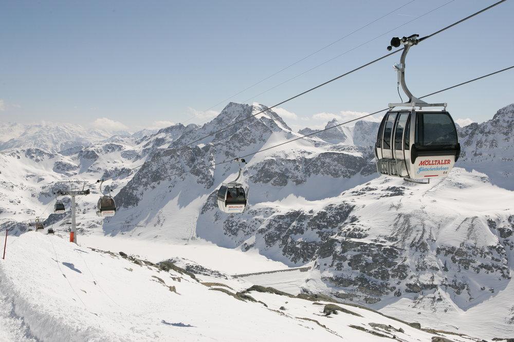 A stream of gondolas carrying visitors up from Flattach to Mölltaler Glacier AUT
