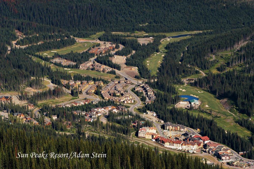 Sun Peaks resort and forests from above