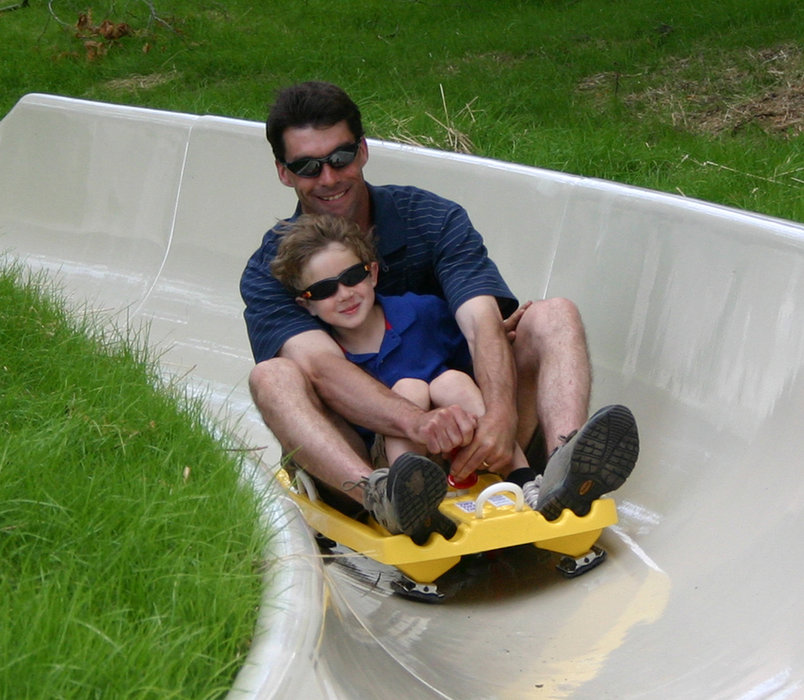 Father and son descending the alpine slide at Crystal Mountain, MI.