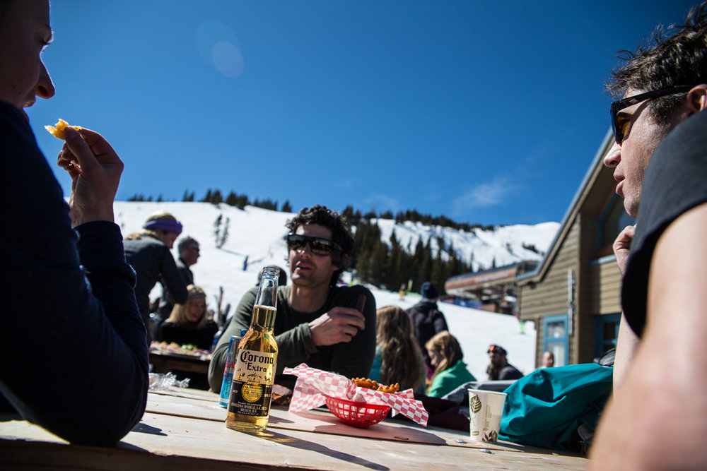 T-shirts, french fries, cold beer and a deck is the way to do lunch at Breck in March. - ©Liam Doran