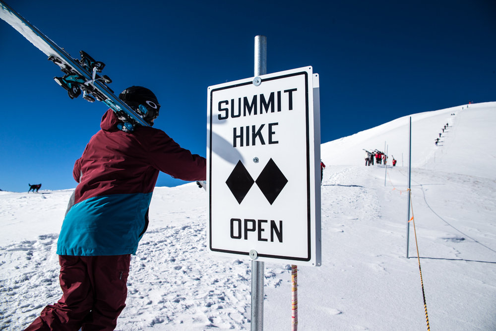 Skier, Greg Day heads up for the first hike of the day on Peak 6. - ©Liam Doran