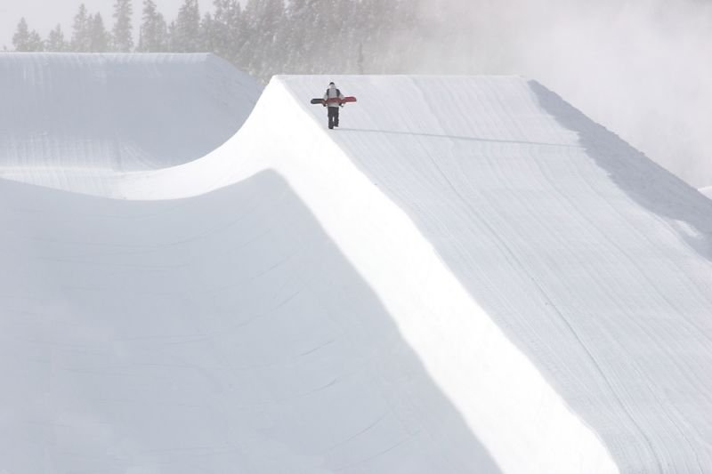 A snowboarder makes his way up the Breckenridge, Colorado Freeway Superpipe