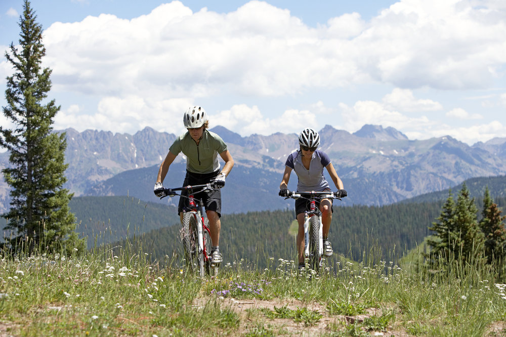 Mountain biking on Vail Mountain offers a great workout plus spectacular views. - ©Chris McLennan
