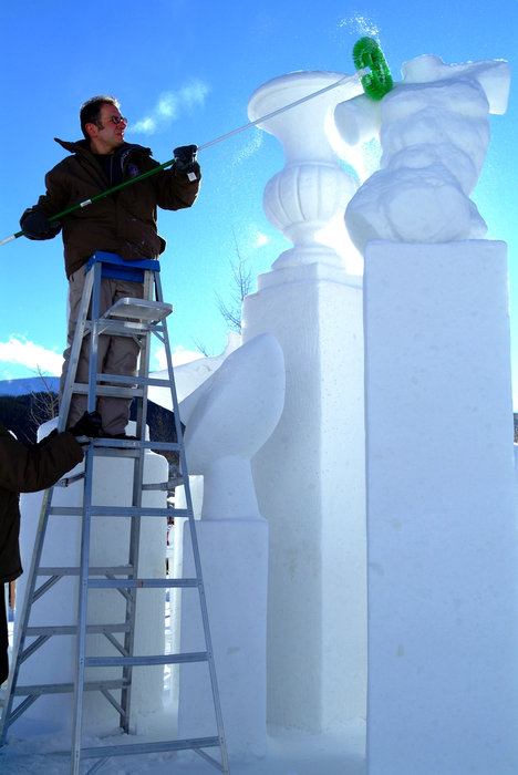 A sculptor carving at the Breckenridge, CO International Snow Sculpture Championships. Image by Jeff Scroggins.