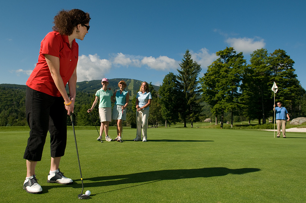 A golfer taking a long putt at Stratton Mountain Resort, VT.