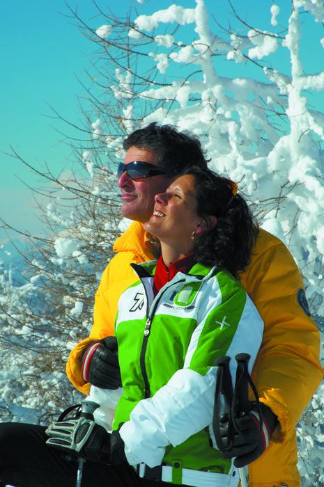 Skiing couple at Bad Kleinkirchheim, AUT