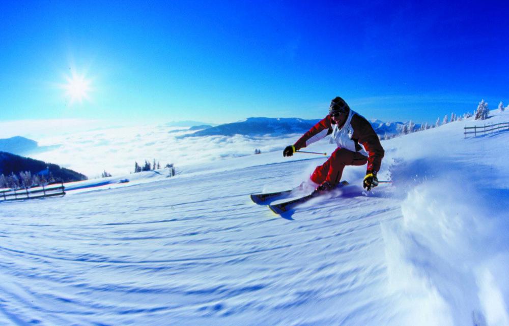 Skier carving a turn at Bad Kleinkirchheim, Austria