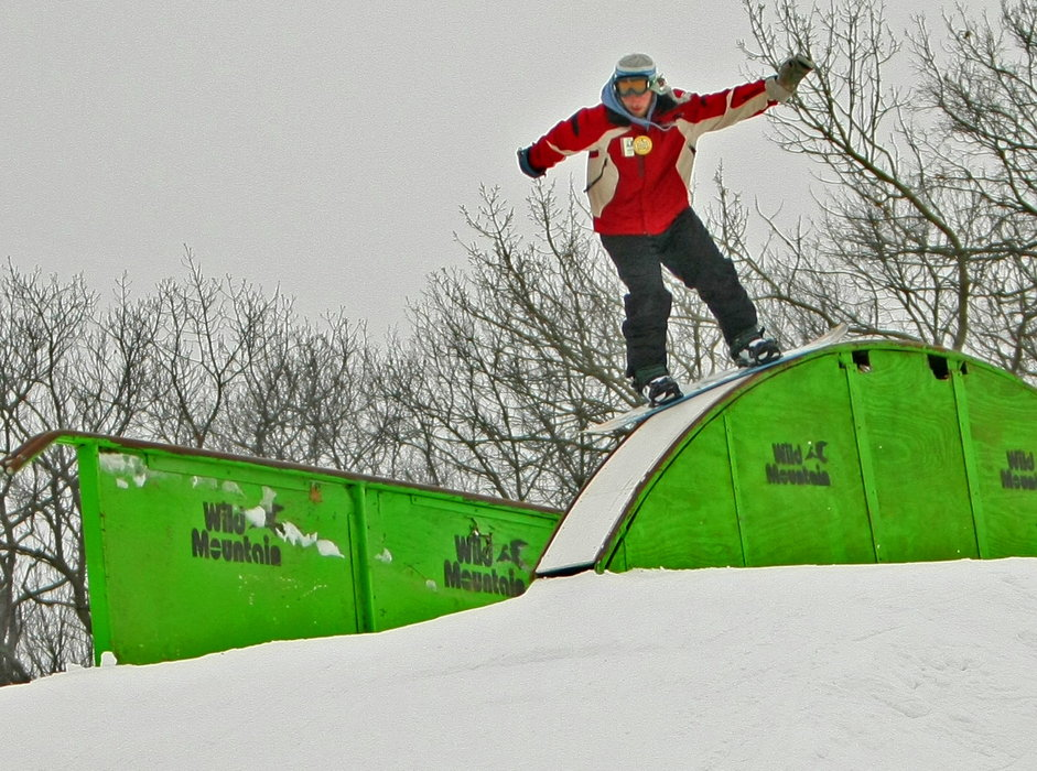 Snowboarder at Wild Mountain terrain park.