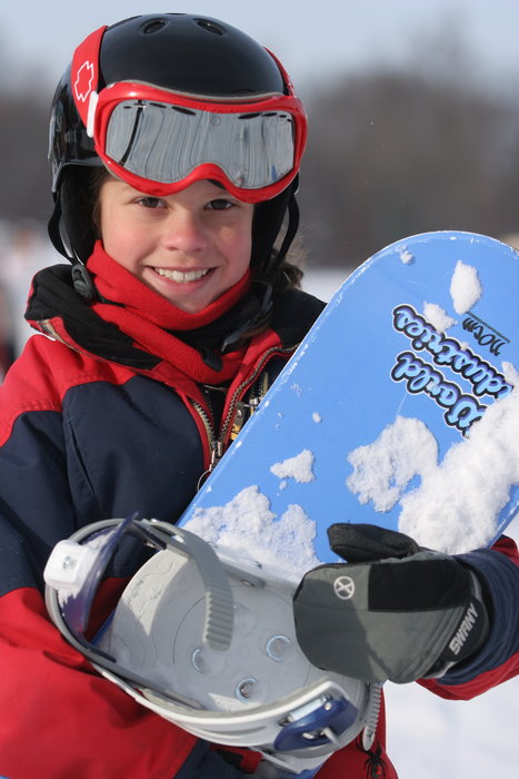 Youth with his snowboard at Wild Mountain, MN