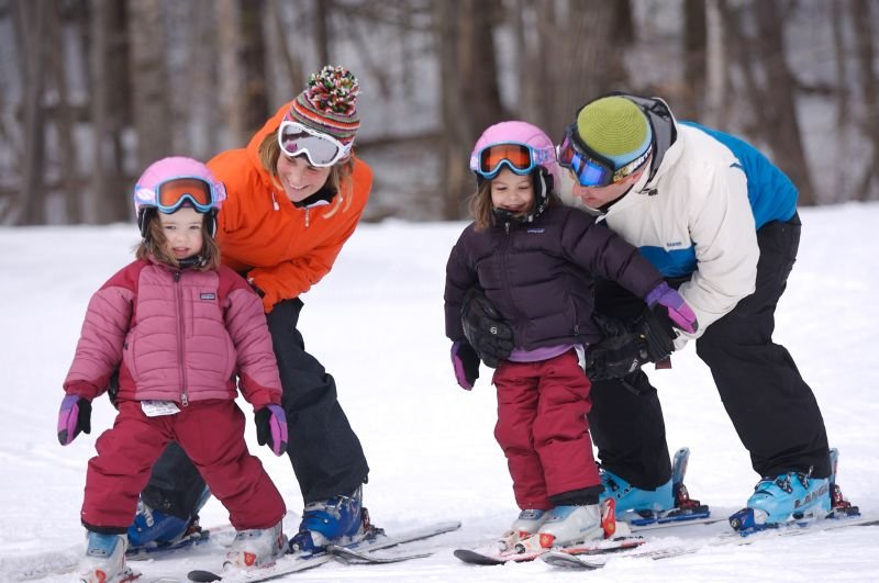 A family learning to ski at Mt Sunapee, NH.