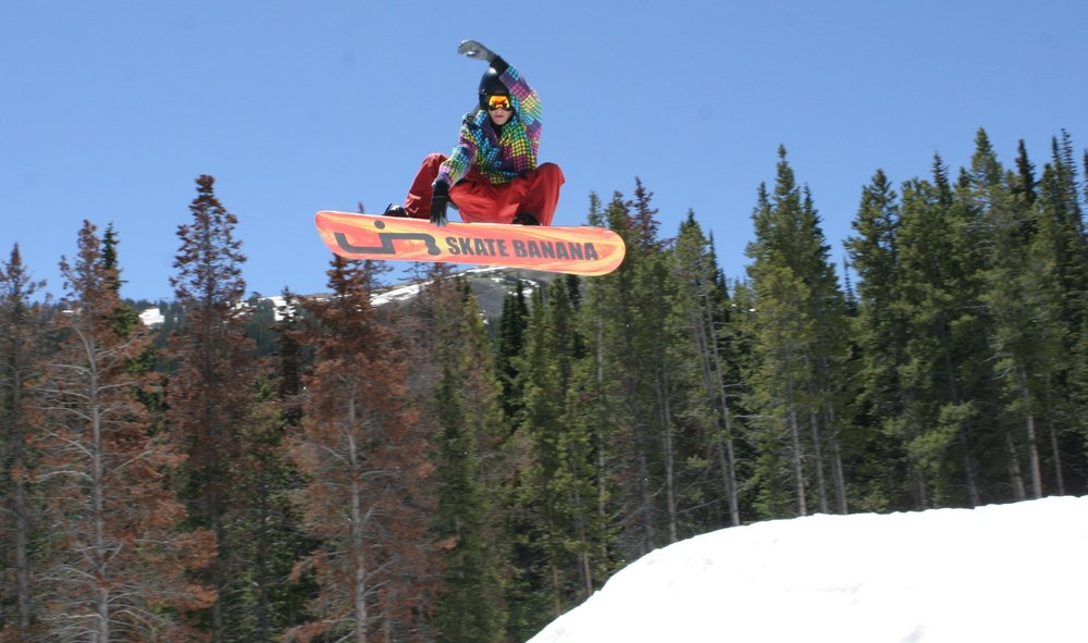 Snowboarder performing a grab at Woodward at Copper.
