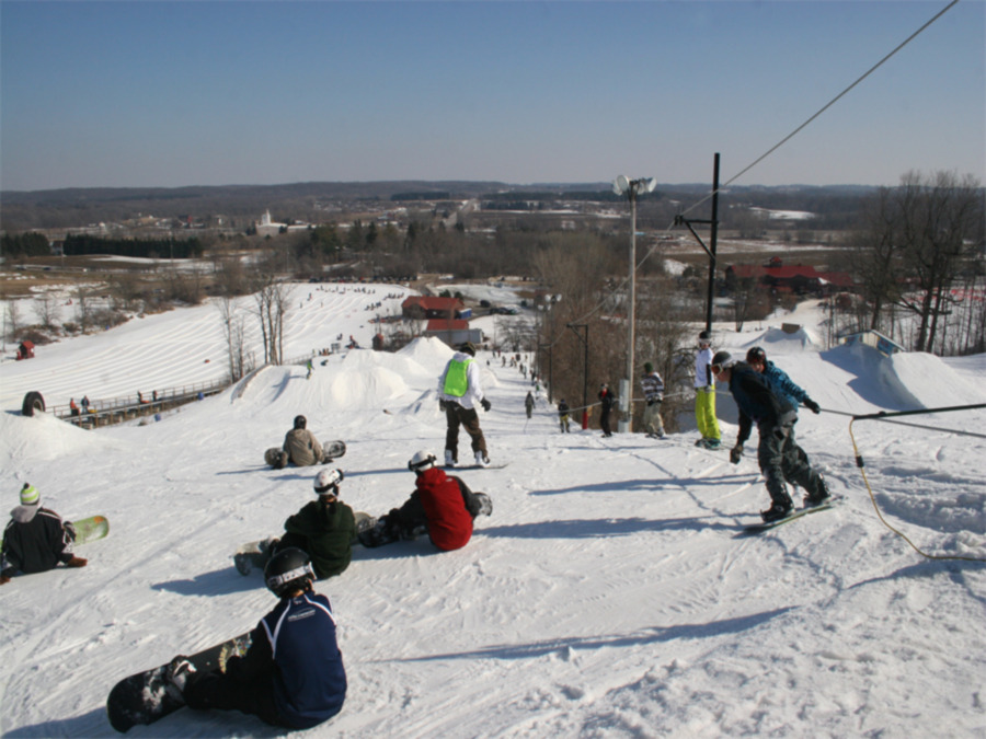 Snowboarders at the Sunburst, WI Progression Park.