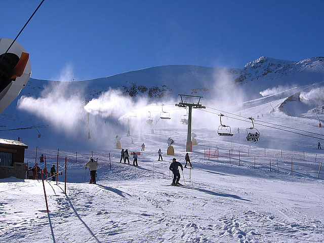 Skiers and snowmaking at Valdezcaray, ESP.