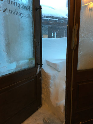 Les Arcs - Loads of snow, still snowing now. No skiing today. Nothing open till later. Took this picture this morning as I tried to get out for fresh croissants. Couldn't open the door!  - ©STU'S PIECE