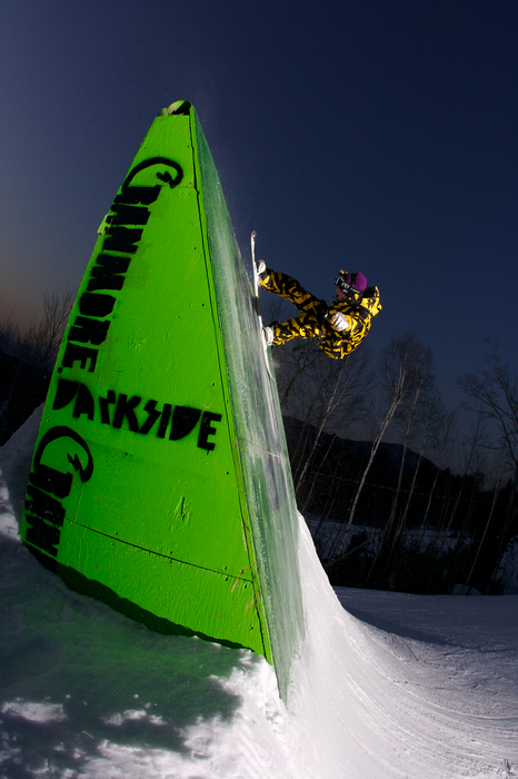 Snowboarder at the terrain park at Cranmore, NH.