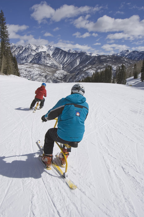 Snowbikers on a groomer at Durango, CO.