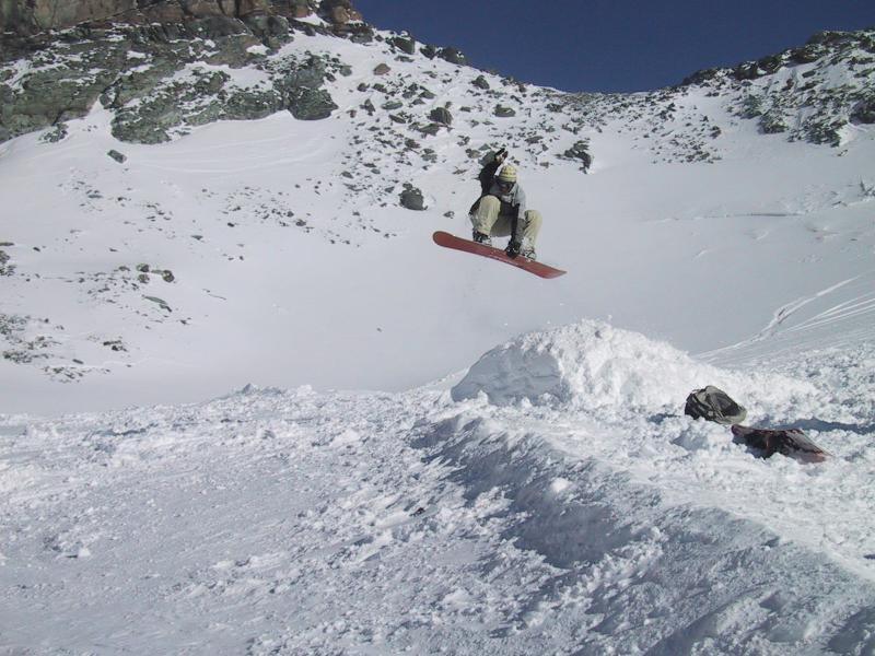 Snowboarder jumping in Cervinia, Italy.