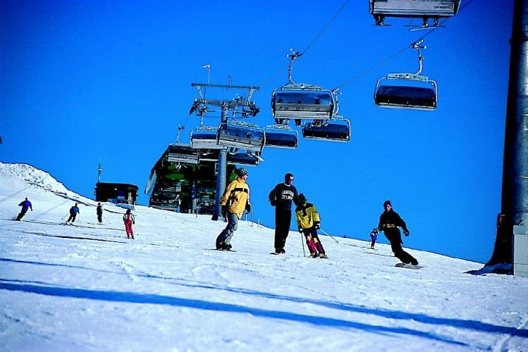 Skiers and boarders under the lifts at Feldberg, Germany.
