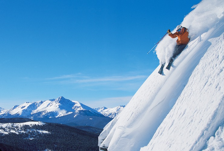 A skier goes down the side of a mountain in Vail, Colorado