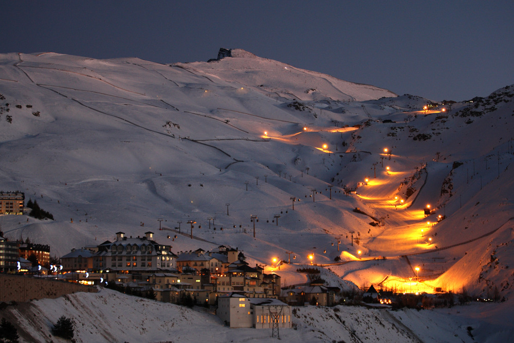 Night skiing in Sierra Nevada, slopes lit up