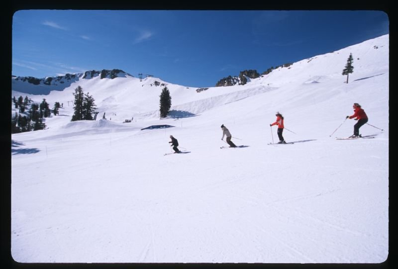 A group of women skiers take a clinic at Squaw Valley Resort, California